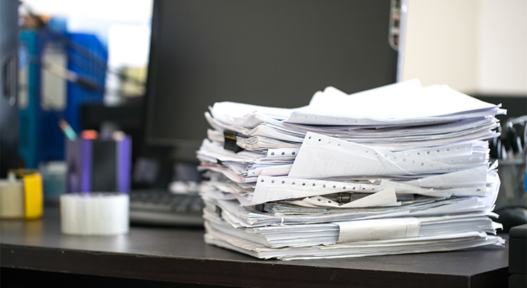 A Big Stack Of Mortgage Paperwork Waiting To Be Filed.