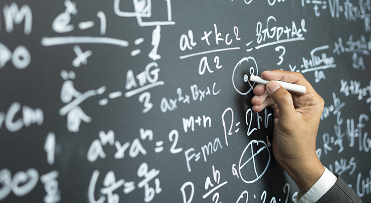 Math On A Chalkboard Signifying The Economic Recovery