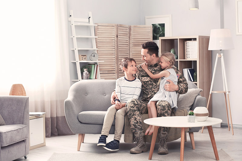 A family sitting in a Portland home purchase with a VA home loan.