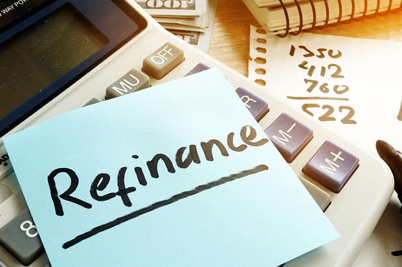 Refinance written on a memo to refinance a home.